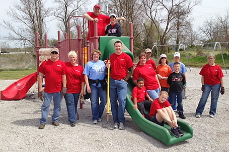 Cardinal Scale employees help fix up a local school playground.