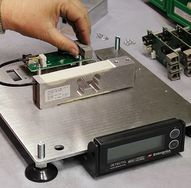 A Cardinal/Detecto load cell installed in an APS series retail POS scale. Cardinal/Detecto's Enterprise® APS series foodservice scales are constructed in the U.S. at the company's factory in Webb City, MO. Cardinal/Detecto stands by the craftsmanship necessary to create the best point-of-sale, food service, ingredient, and portion scales on the market.